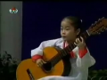 Little North Korean Girl Playing Guitar