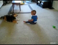 Baby laughing at Dog
