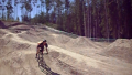 Brendon and Jerry Birkenstock and Kieth Nolan and Austin Friesen mountain biking and jumping at Vanderhoof bike park