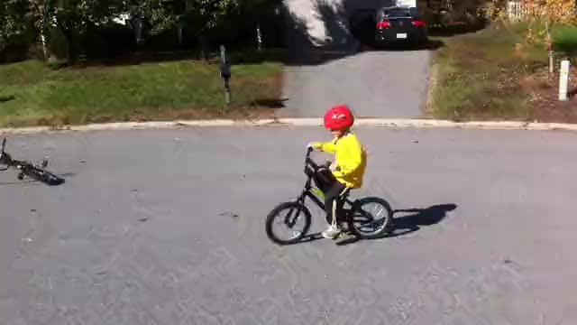 Campbell riding his bike without training wheels