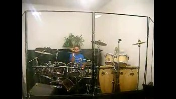 Isaiah Playing the drums