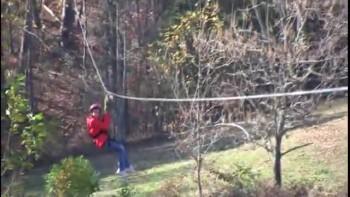 Kat rides the zipline