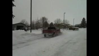 Stuart snowplowing church lot