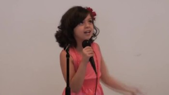 7 year old girl sings and wows over 200 students in alternative school