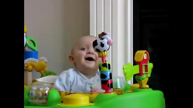 Baby is afraid, then laughs at Mom