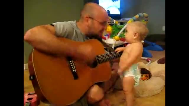 Cute Baby Loves Rock & Roll!