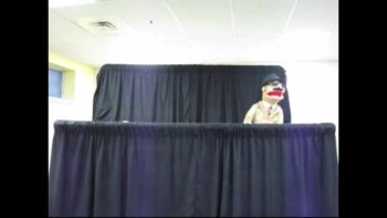 Sacred Agent Man Puppet Show