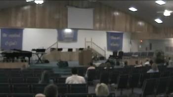 J.F Holmes preaching at church of god