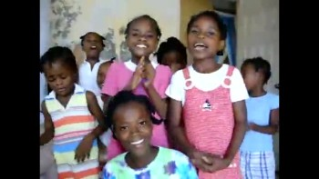 Happy Haitian girls sing I've Got the JOY