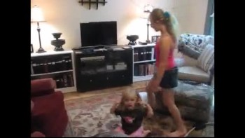 Sami teaches little girl how to do handstand