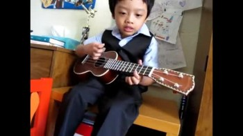Four Year Old Plays Ukulele & Sings Jesus Loves The Little Children