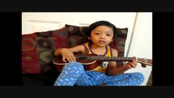 Four Year Old Plays Ukelele & Sings