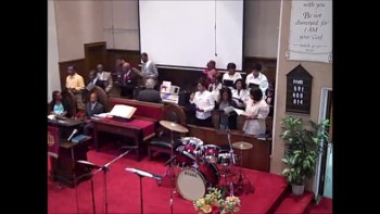 "St. Clair RockSteady Choir sings ""While I'm Down Here Waiting"""