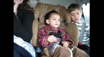 Little Toddler Singing Tobymac in Carseat