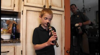 Justin playing recorder with his nose