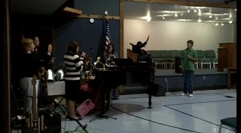 Justin Cummings singing Yaweh with other members of Wellington First Baptist Church