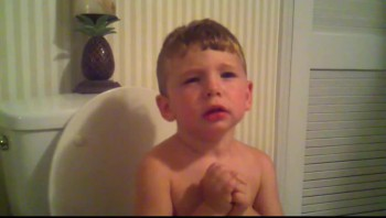 Adorable!  Father and Son Pray for potty time