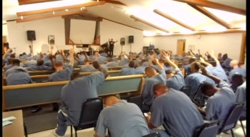 Men responding to the Lord's call during the Shooting Stars Prison Tour