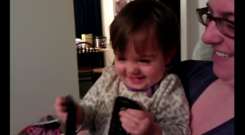 Baby with TV remotes - contagious laughter!