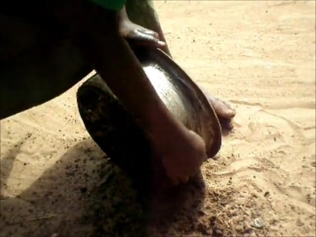 Cleaning Pots with Dirt