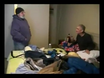 Tony Tona Visiting With a Homeless man