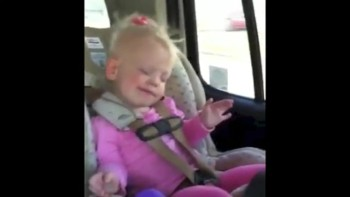 Adorable Toddler Rocks Out to Music in the Car!