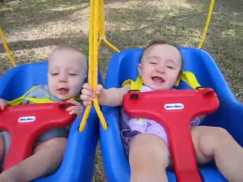 These Happy Twins Giggling on a Swing Will Make You Smile!
