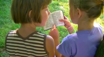 Children enjoy reading the word of God from the Bible