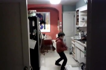 Kid is Caught Doing Something Hilarious (and Cool!) While Washing Dishes