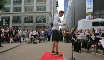 An Impromptu NYC Orchestra Lets Pedestrians Conduct