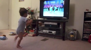 Toddler Learns to Swing Dance While Watching TV