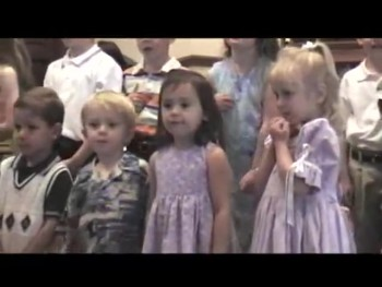 Hilarious Little Boy Steals the Show During a Church Performance. What a Ham!