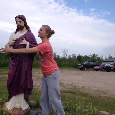 Teen Hugging Statue