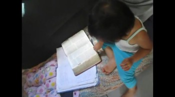 1 year old reading the Bible