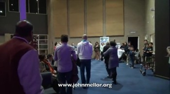 Brain damaged cripple walks out of wheelchair - John Mellor Healing Evangelist