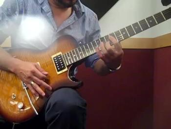 AJ playing at Guitar Center