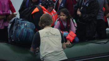 Rescuers Lift Refugees to Safety