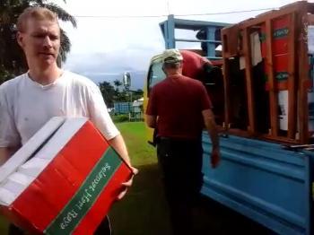 Unloading crates in Manokwari