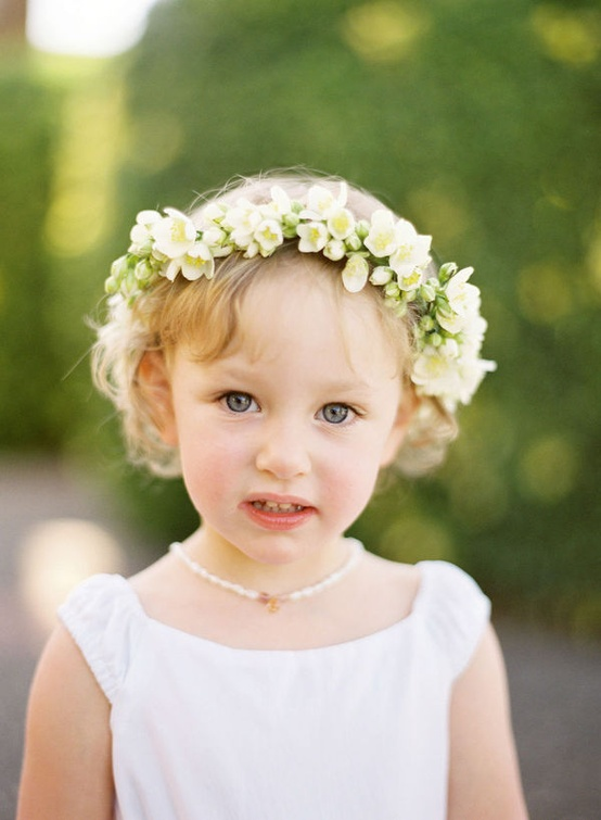 Little girl wearing pearls.